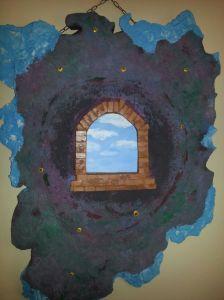 FINESTRA SULL'INFINITO -     Serie di opere che hanno una forma non forma, perchè l'infinito non può essere rinchiuso in una forma che potrebbe aver senso  rinchiudere ciò che non può avere confini. La parte azzurra rappresenta quanto noi vediamo, la parte più scura quanto non vediamo, ma noi siamo i padroni di quella finestra che dobbiamo sempre tener aperta perchè solo così possiamo vedere e penetrare in quel buio.
