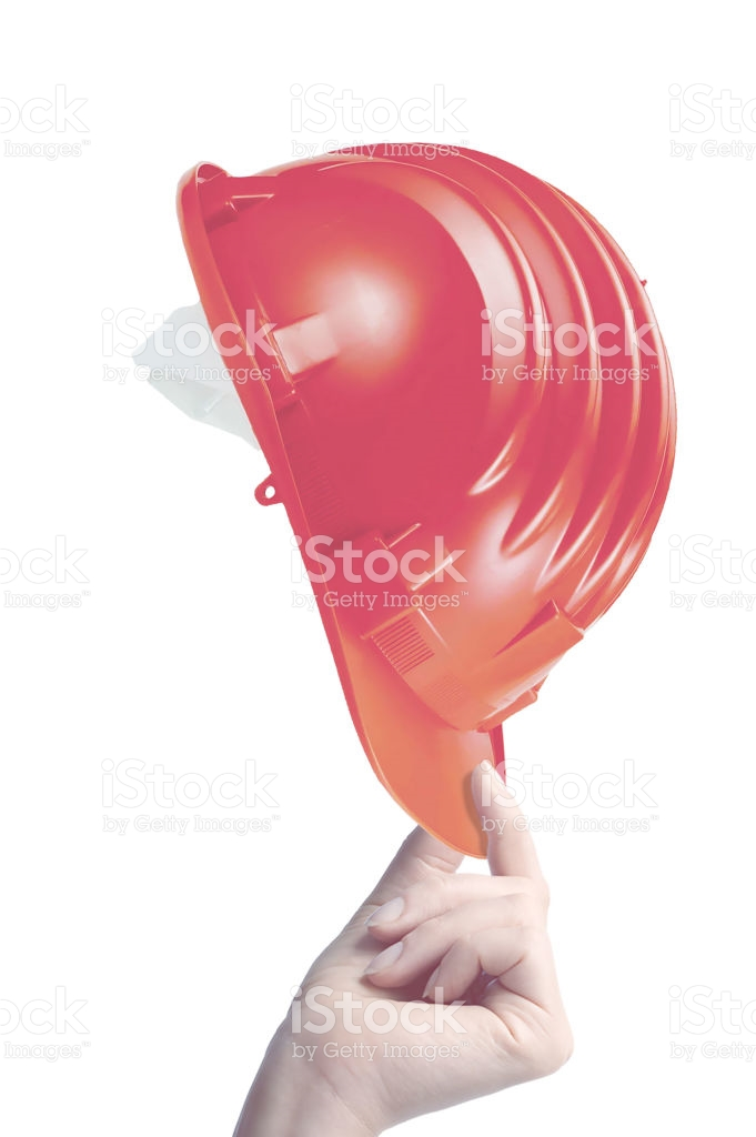 hand holding construction helmet on white background